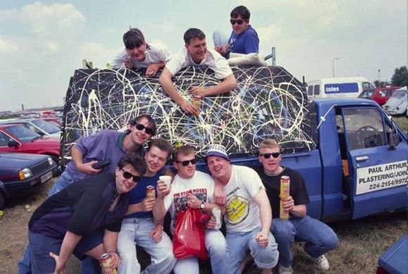 Bonehead, Guigs (bottom left) and gang, with Bonehead's Pollock'd truck at Spike Island, 1989. Credit: Ian Tilton